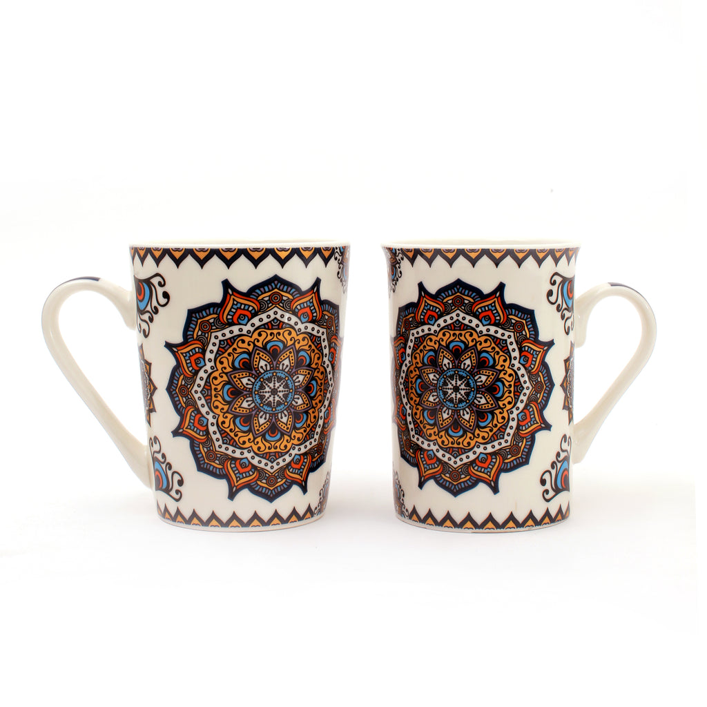 Two ceramic mugs with mandala designs