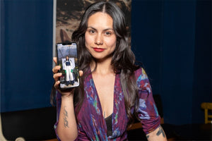 Woman holding iPhone with Contemporary Fashion magazine on the screen. Pure Free Spirit is featured in issue 3 of this magazine.
