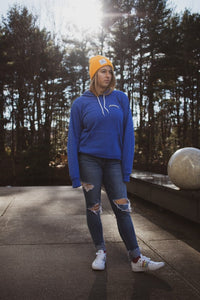 model sporting blue hoodie with beanie