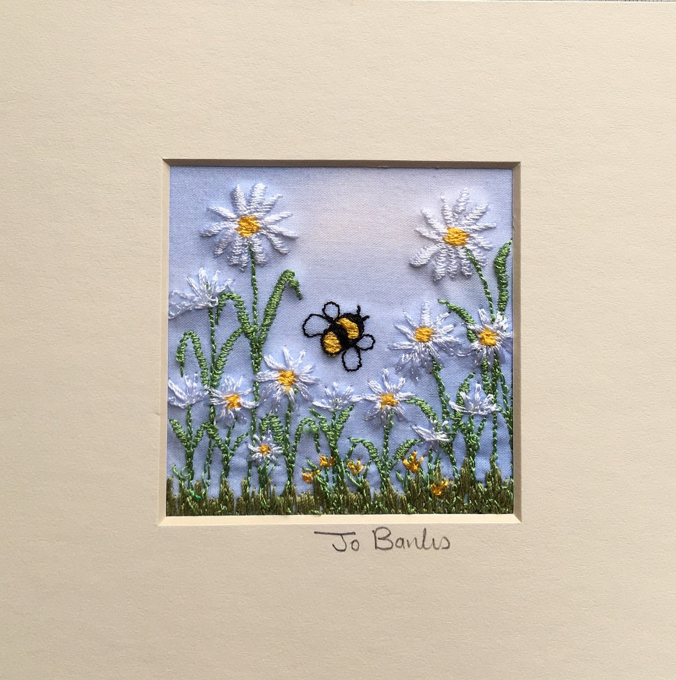 Daisies with bee
