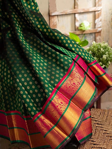 Dark Green Colored Function Wear Banarasi Silk Saree With Reach Pallu Border For Women