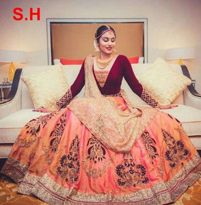 Outstanding Orange Colored Partywear Designer Embroidered Paper Silk Lehenga Choli