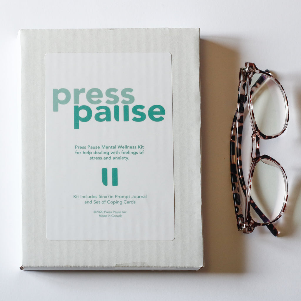 Press Pause kit with glasses beside it