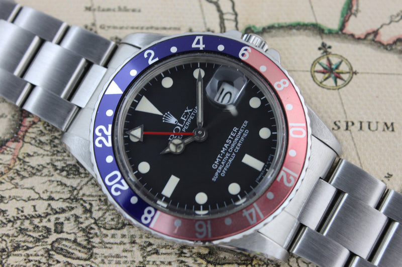 1985 - Rolex GMT Master Pepsi (With Box and Service papers from RSC UK 2009 - Momentum Dubai