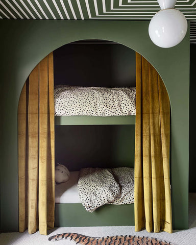Green bunk beds with patterned ceiling