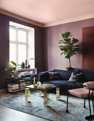 Purple living room with a lilac ceiling