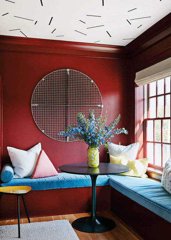 Red banquette with a patterned ceiling