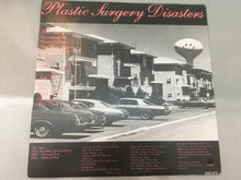 Load image into Gallery viewer, Dead Kennedys ‎– Plastic Surgery Disasters, Green Vinyl LP, Statik Records ‎– STAT LP 11, 1982, Australia