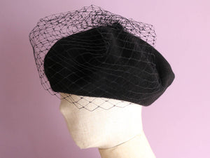 A Black Wool Beret with veil