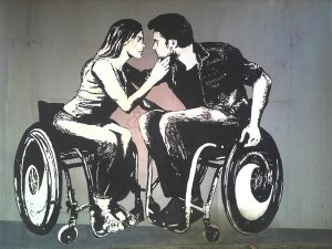 image of lovers in wheel chairs