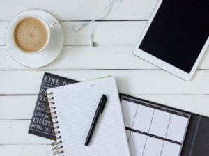 Checklist - Image of a cup of coffee, notebook & Ipad