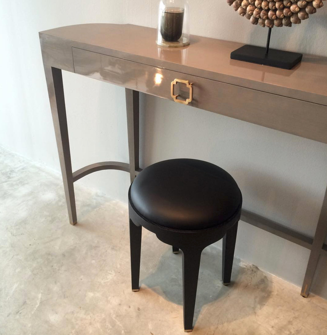 medaillon, medaillon console, lacquer console, beige console, high shine lacquer, brass, eastern, ming style, Chinese style, asian style, akar de Nissim, luxury furniture, designer furniture, minimalist, guimar barstool, guimar stool, black stool, barstool, akar logo, classic candle, akar de Nissim candles, glass dome, candle holder, fluid design, leather upholstery,