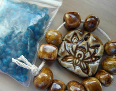 Ceramic Lotus Bead and Blue African Glass Beads. Projects in the works.