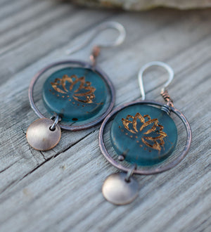 Copper hoop earrings with blue glass lotus beads at the center with golden highlights. Brass circle dangles. Bohemian Style Earrings that are handmade.