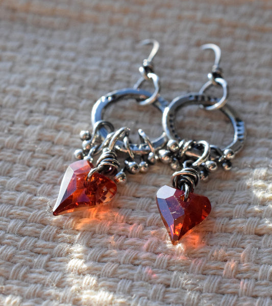 You cannot beat the Sparkle of thes Swarovski Crystals. I love these red heart crystals! Silver Hoop earrings by Cindy's Art and Soul Jewelry