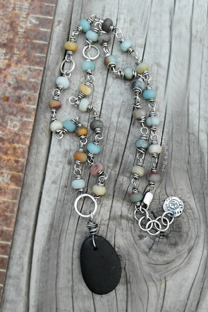 Large sized Beach Stone wrapped in sterling silver, beaded necklace.
