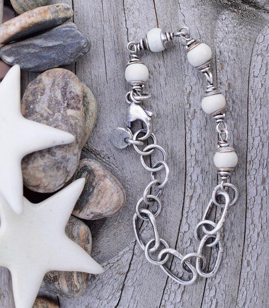 Alabaster, creamy white porcelain beads with rustic handcrafted silver links. This bracelet is handmade from start to finish from raw clay to pure, raw silver.