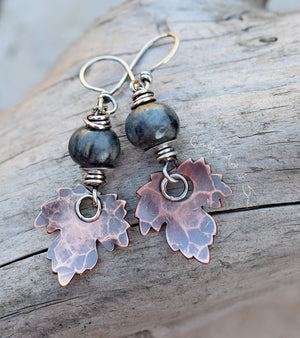 blue handmade ceramic beaded earrings with pure copper leaf charms. shades of autumn.