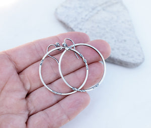 minimalist jewelry. all silver hoops. Silver hoop earrings.