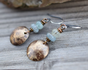 Aquamarine Gemstone earrings with golden brass charms.