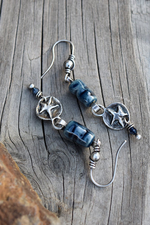 Silver Star Earrings in Montana blue handcrafted by Cindy's Art and Soul. Wrapped with pure silver wire.