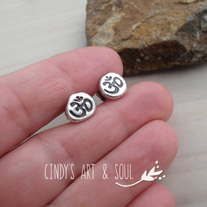 Om earrings size comparison