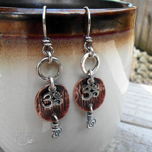 Om earrings with small silver hoops