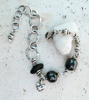 Black stone bracelet with handcrafted porcelian and silver chain.