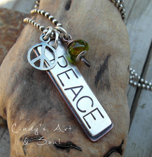 Handmade necklace with a bold PEACE loving charm. Peace sign and artist handmade lampwork bead. Designer Jewelry.