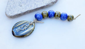handcrafted ceramic art beads. Fish pendant. Blue and Green.