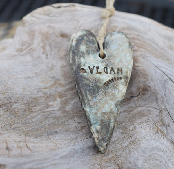 Vegan for the animals. Handcrafted porcelain heart pendant