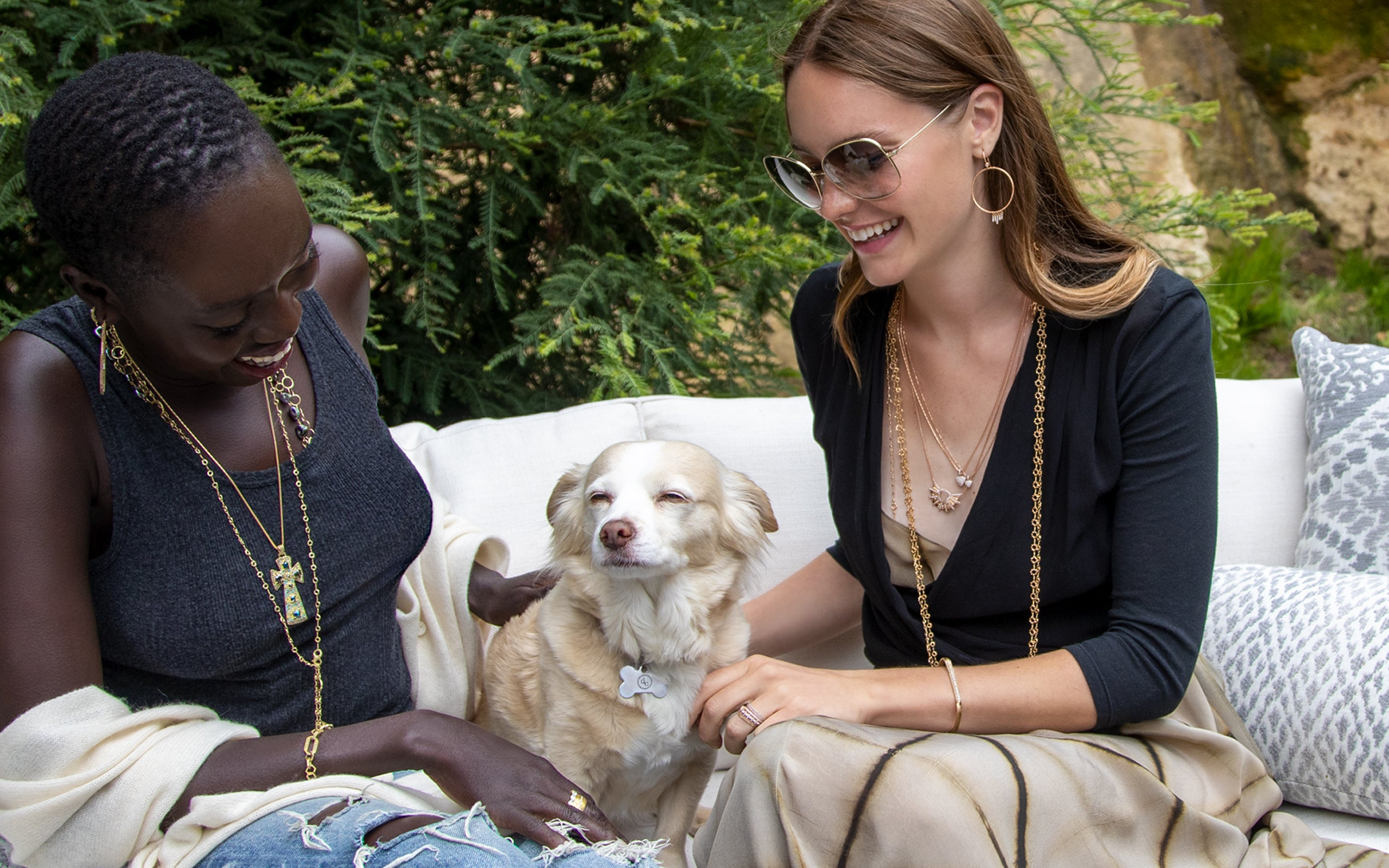 Pair of models with dog wearing versatile must-have 18k jewelry at an afternoon get-together; phone 323-404-2959 for assisted shopping.