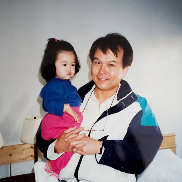 Toddler Ada and her dad, wearing bright 90s colors