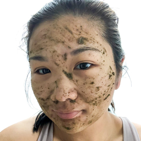 Ada, a Taiwanese American woman, with green tea powder cleanser paste spread evenly on her face