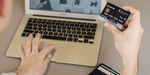 Making payments online with credit card and laptop