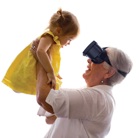 Grandmother wearing AceSight wearable technology and lifting grandchild up.