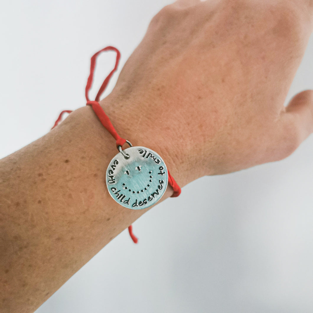 Every Child Deserves to Smile Bracelet - ID: 124003, Red