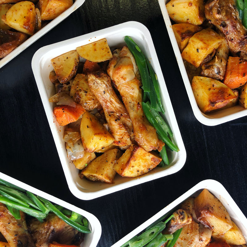 Chicken drumsticks (2) with roasted potatoes and vegetables