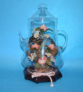 Glass noventy teapot with internal floral display