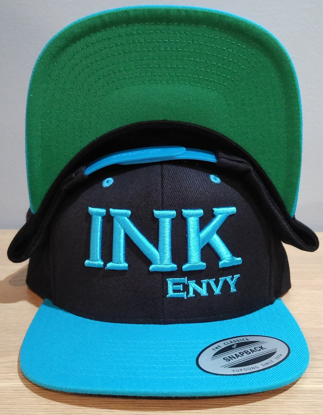 Bold INK Turquoise on Black SnapBack With Puff Lettering