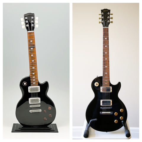 real Gibson Les Paul guitar with glass sculpture of the guitar
