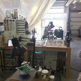 cutting table with the tile saw and grinder in the background
