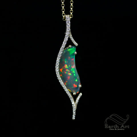 Black opal pendant in gold and diamonds