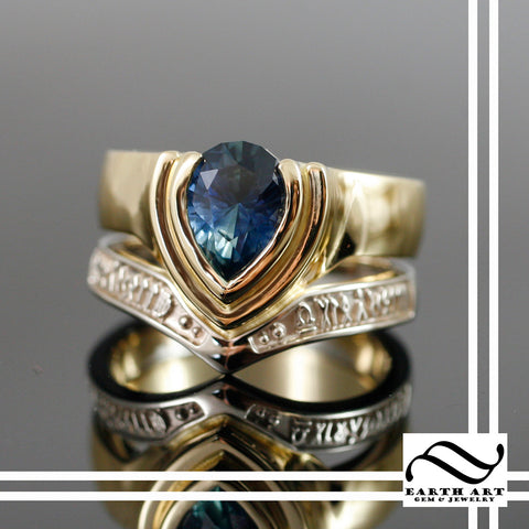 A custom sapphire ring in white and yellow gold