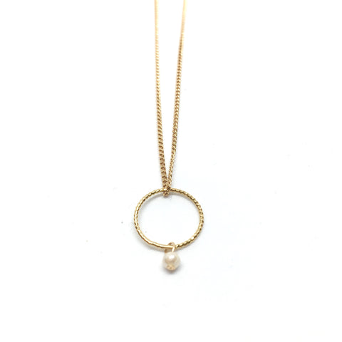 Circle and pearl pendant