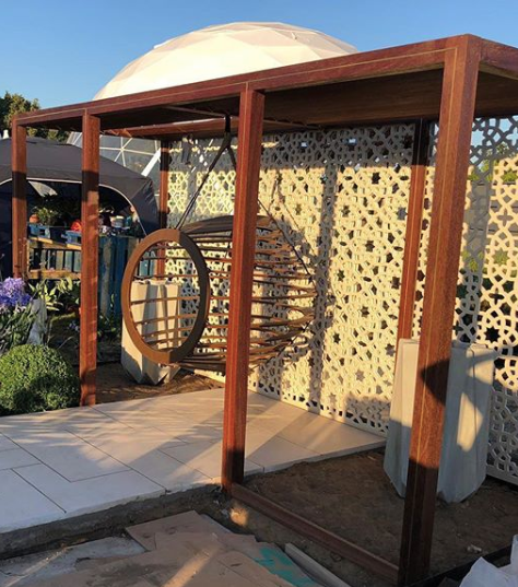 Cream geometric large Alhambra screens installed in a show garden at RHS Hampton Court