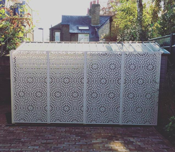 Garden shed screening idea by Screen With Envy. Cream decorative panels hide a shed in London.