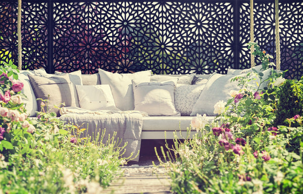 Stunning designer black geometric screen installed behind an outside sofa