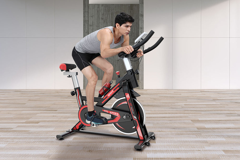 Hands and Back Naturally Bent on the Stationary Bike