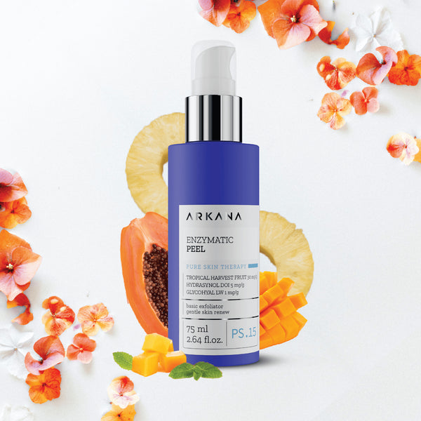 "Tall navy blue 75 ml bottle with white pump and clear case. Black text on light grey label reading, ""Arkana - Enzymatic Peel. Tropical Harvest Fruit, Hydrasynol DOI 5 mg/g, Glycohyal LW. Basic Exfoliator Gentle Skin Renew. Part of Pure Skin Therapy. Centred in front of papaya, mango, 2 pineapple rings in off white background."